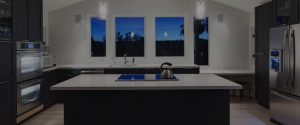 quartz worktops in kitchen with night time view from windows