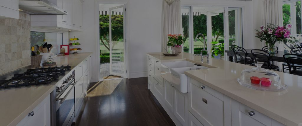 kitchen with countertop with sink flowers to decorate and open patio door to garden